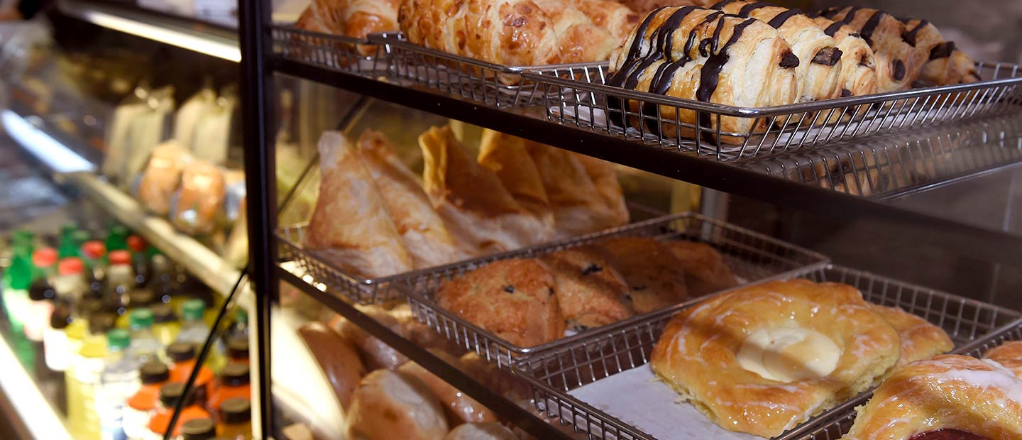 Close up of fresh pastries in glass case