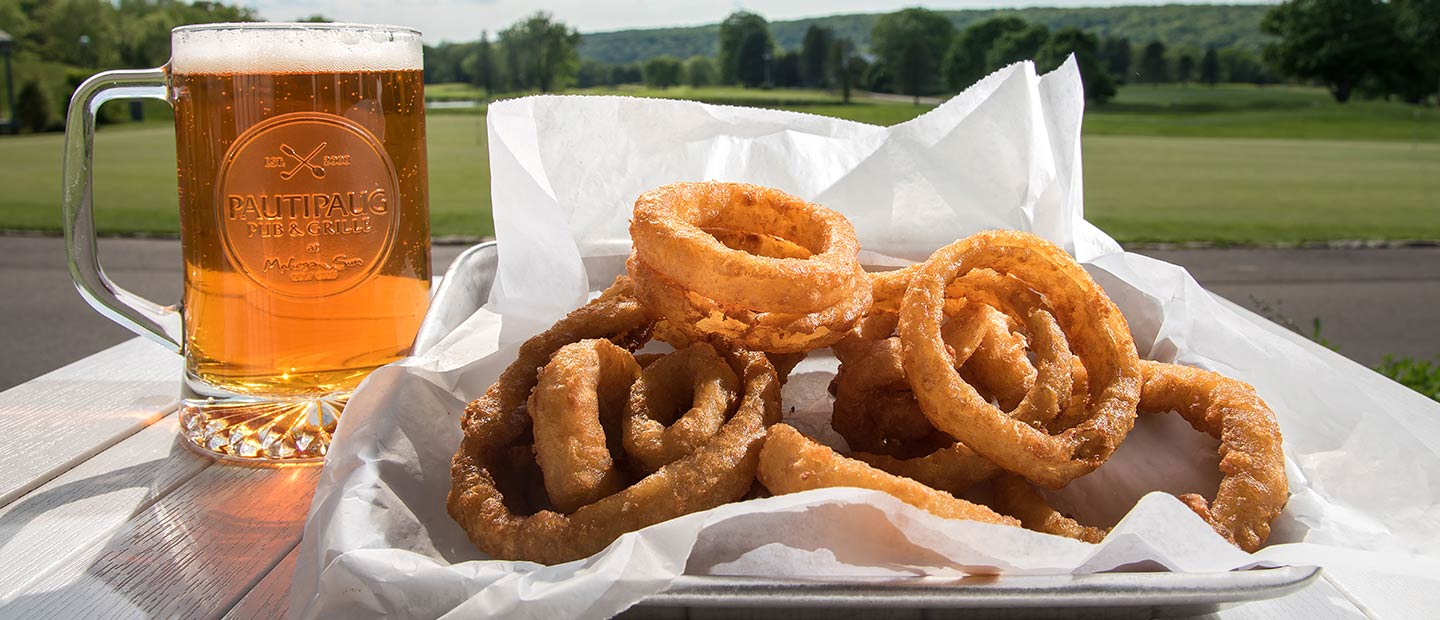 Beer and onion rings with golf course in background