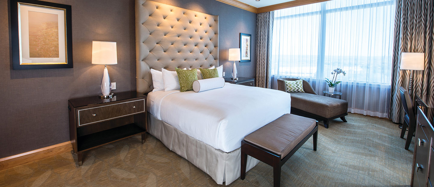 Aspire Luxury Suite with tufted headboard