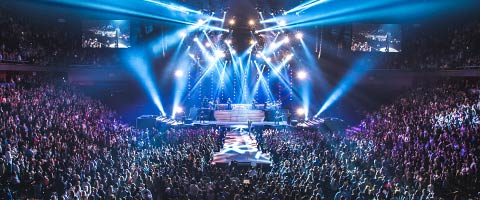 wide shot of the arena during concert with blue lights