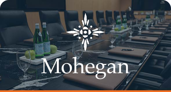 Corporate Boardroom and Mohegan Gaming and Entertainment Logo